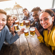 Happy multiracial group of friends taking a selfie drinking a beers at party - PhotoDune Item for Sale