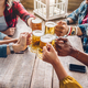 Group of people enjoying and toasting a beer in brewery pub - PhotoDune Item for Sale