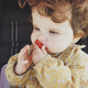 Little baby girl eating a strawberry - PhotoDune Item for Sale