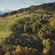 Mountain village at top aerial. Autumn nobody nature landscape. Green trees, grass at cottages - PhotoDune Item for Sale