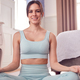 Portrait Of Woman Wearing Fitness Clothing In Bedroom At Home Sitting On Yoga Mat And Meditating - PhotoDune Item for Sale