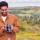 Man With Digital DSLR Camera Taking Photos In Countryside - PhotoDune Item for Sale