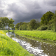 Heavy clouds above the river Aa near Heeswijk - PhotoDune Item for Sale