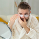 Bearded man applying eye patches on his face. Wrinkles and face home care for men - PhotoDune Item for Sale