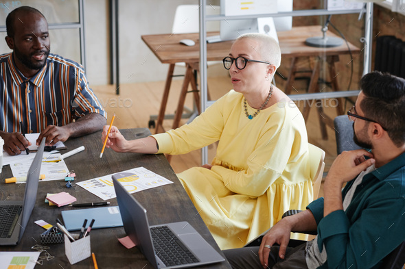 Business leader talking to her employees - Stock Photo - Images