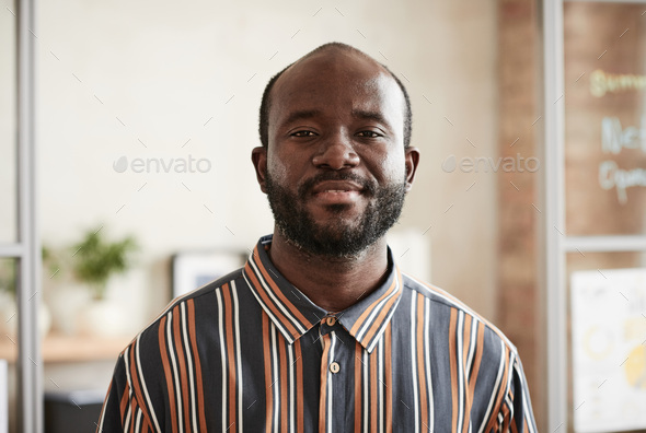 African man standing at office - Stock Photo - Images
