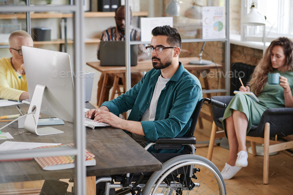 Disabled businessman working on computer - Stock Photo - Images