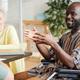 Disabled businessman talking at meeting - PhotoDune Item for Sale