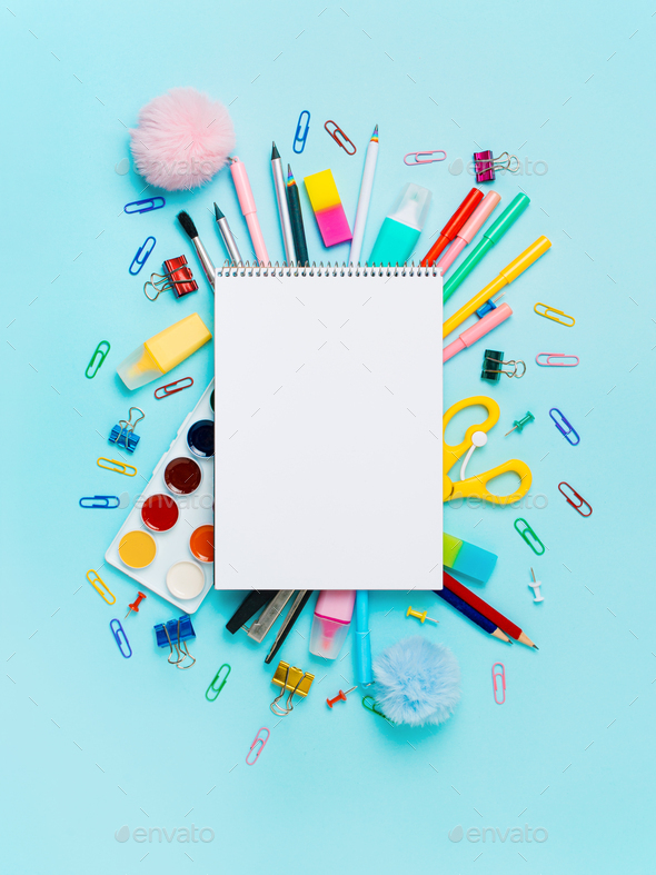 School supplies and empty notebook on blue bckg - Stock Photo - Images