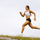 Determined Fit Female Athlete Running On Mountain Against Sky - PhotoDune Item for Sale