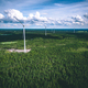 Windmills. Aerial view of windmills in green summer forest in Finland. - PhotoDune Item for Sale