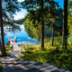 Wooden pier with bench for rest on a blue lake in Finland - PhotoDune Item for Sale