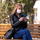 Masked Girl is Texting on the Phone - VideoHive Item for Sale
