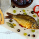 Baked fish carp, stuffed bell peppers and grapes. The top view. - PhotoDune Item for Sale