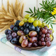 Freshly picked grapes in several varieties of clay bowl on a light background. - PhotoDune Item for Sale