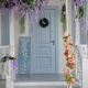 House facade with blue door, porch, staircase and courtyard - PhotoDune Item for Sale