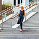 Elegant fashionable woman descending exterior steps in town - PhotoDune Item for Sale