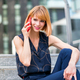 Attractive stylish woman smiling as she chats on a mobile - PhotoDune Item for Sale