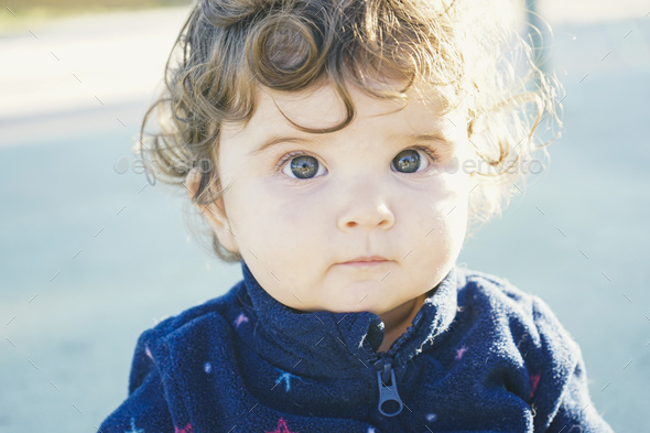 Lovely toddler portrait in a sunny day - Stock Photo - Images