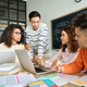 Four multiethnic colleagues brainstorming discussing project in modern office. - PhotoDune Item for Sale