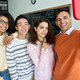 Four happy multiracial students making selfie on black board background. - PhotoDune Item for Sale