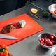 sliced meat on cutting board with vegetables at restaurant kitchen - PhotoDune Item for Sale