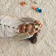 overhead view of happy little girl playing with cubes at home - PhotoDune Item for Sale