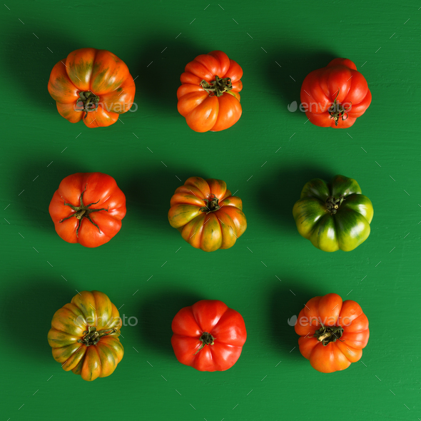 Green and red tomatoes concept - Stock Photo - Images