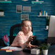 Tired elementary student joining online lesson from home - PhotoDune Item for Sale