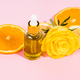 Vitamin C serum bottle with dropper on pink background with orange citrus slices - PhotoDune Item for Sale