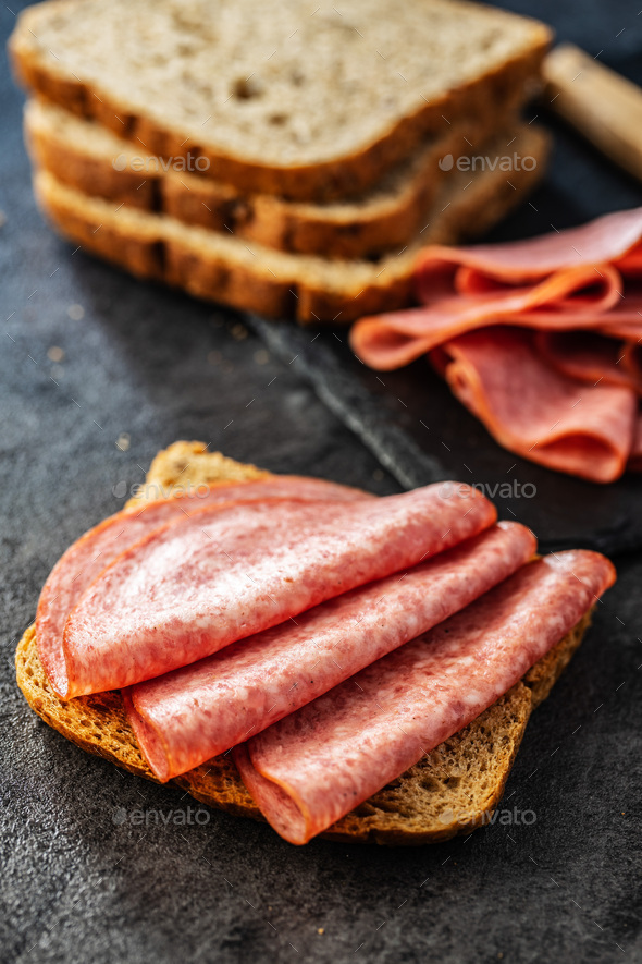 Slice of bread with salami - Stock Photo - Images
