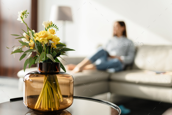 Middle aged woman decorating living room - Stock Photo - Images