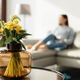Middle aged woman decorating living room - PhotoDune Item for Sale