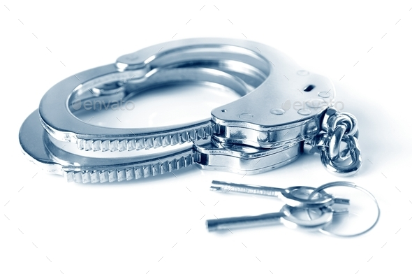 Metal handcuffs and keys isolated over white background - Stock Photo - Images