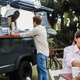 Multiracial people eating at food truck restaurant outdoor - Focus on hispanic woman face - PhotoDune Item for Sale