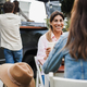 Happy people having fun eating and drinking outdoor at food truck restaurant - Focus on woman face - PhotoDune Item for Sale