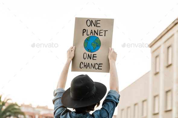 Demonstrator on the city protesting against climate change - Global warming and environment concept - Stock Photo - Images