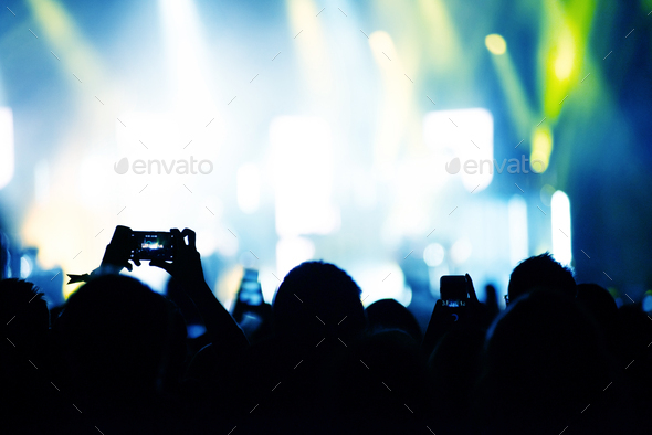 Raised arms holding smart phones to recording a live concert - Stock Photo - Images