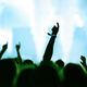 Rear view of crowd with arms outstretched at concert - PhotoDune Item for Sale