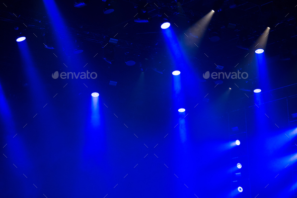 Stage lights glowing in the dark - Stock Photo - Images