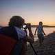 Young father taking photo of his son on the beach - PhotoDune Item for Sale