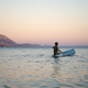 Boy sitting on the rear end of sup board - PhotoDune Item for Sale