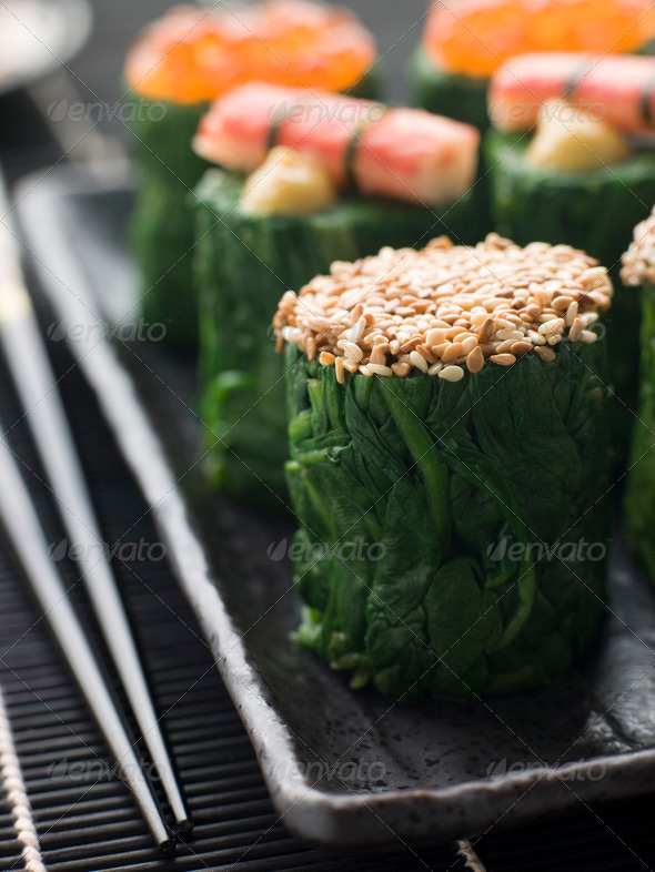 Rolled Spinach Three Ways-Snow Crab Toasted Sesame Seeds and salmon Roe - Stock Photo - Images