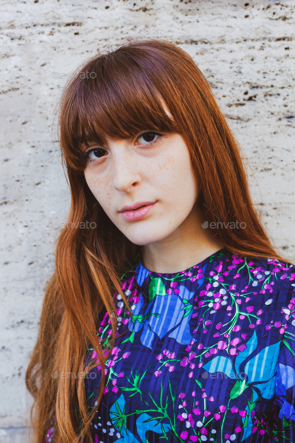 Portrait of a woman with red hair and freckles - Stock Photo - Images
