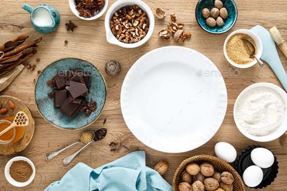 Culinary background with ingredients for baking Thanksgiving or Christmas sweet bake on wooden table - Stock Photo - Images