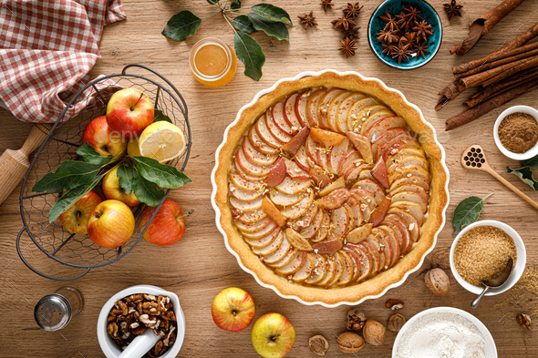 Thanksgiving autumn apple pie with fresh fruits and walnuts on wooden table, top view - Stock Photo - Images
