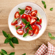 Tomato salad with onion, fresh basil and olive oil, top view - PhotoDune Item for Sale