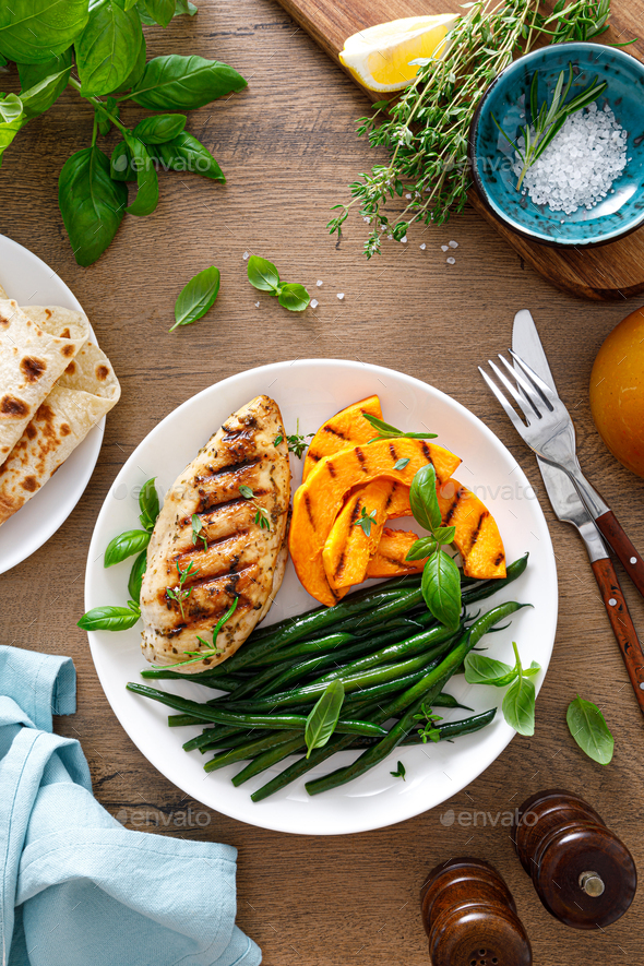 Grilled chicken breast with green beans and butternut squash, top view - Stock Photo - Images