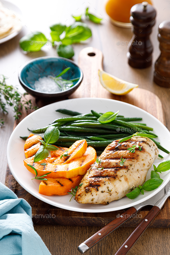 Grilled chicken breast with green beans and butternut squash - Stock Photo - Images