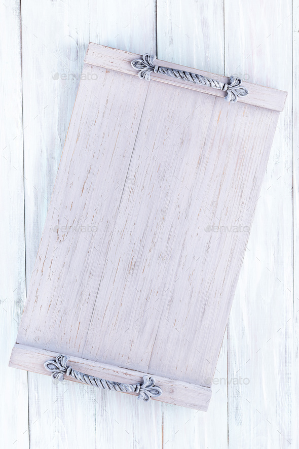 Empty rustic gray wooden tray with handles on wooden background, vertical, top view, copy space - Stock Photo - Images